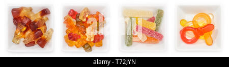 Collection de différents bonbons aux fruits de la gomme dans des bols en vue supérieure