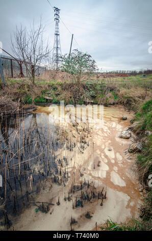 La terre et la pollution de l'eau Banque D'Images