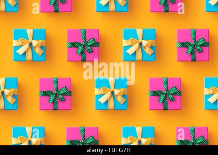 Plusieurs boîtes cadeaux organisé sur fond jaune, vue du dessus Banque D'Images