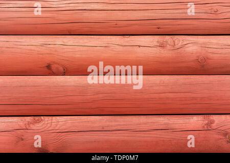 Fragment d'un mur de bois peint en couleur rouge pour être utilisé comme un motif de fond. Banque D'Images