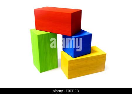 Quatre briques en bois multicolores Banque D'Images