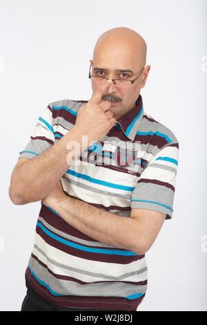 Portrait of a man adjusting his eyeglasses