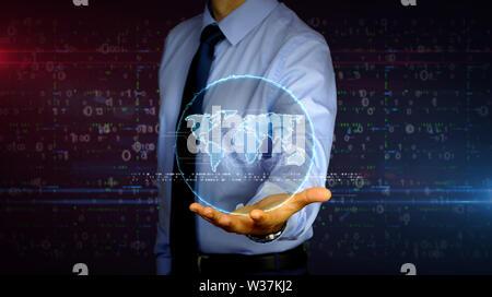 Homme avec monde hologramme sur la main. Businessman showing concept futuriste de la mondialisation, réseau mondial, international business and social media c