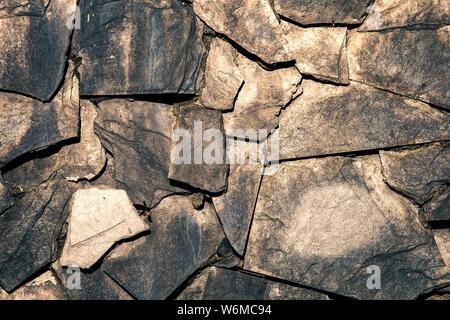 Mur texturé couvert par ardoise gris intégré Banque D'Images