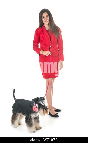 Schnauzer nain et woman in front of white background
