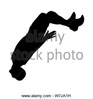 L'homme effectue un saut avec un flip back silhouette Banque D'Images