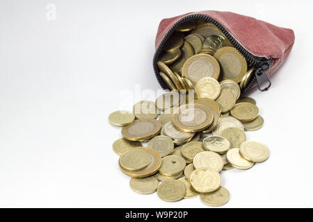 Coin purse filled with coins isolés Banque D'Images