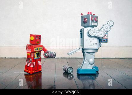 Robot rouge aider grand format argent robot avec un problème d'alimentation Banque D'Images