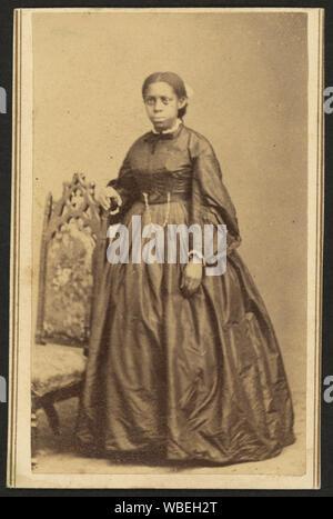 Portrait en pied d'un African American Woman, debout à côté d'une chaise] / photographié par William Abel, Flamington, N.J. Abstract/moyenne: 1 impression photographique sur carte de visite mount: albumen; 10 x 6 cm.