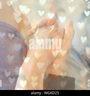 Image Composite numérique du couple Holding Hands Banque D'Images