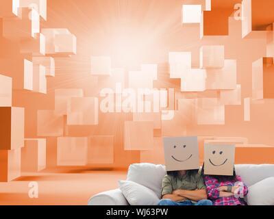 Image composite de silly employés avec bras croisés portant sur leurs têtes des boîtes en orange avec des cubes 3d Banque D'Images