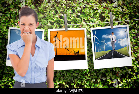 Composite image of businesswoman looking at l'appareil photo sur un fond blanc Banque D'Images