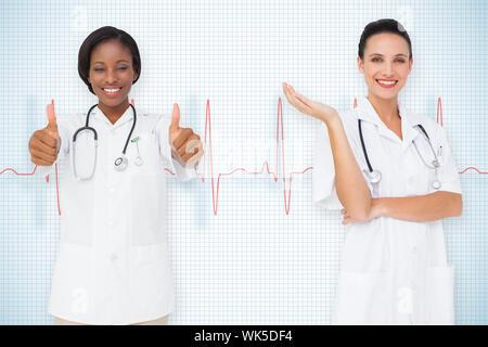 Image composite de l'équipe médicale contre ligne ecg sur fond blanc avec grille Banque D'Images
