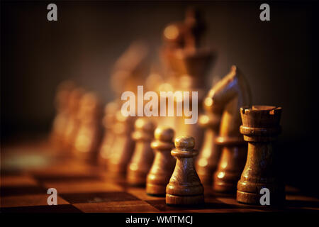 Close-up of wooden Chess Pieces On Board