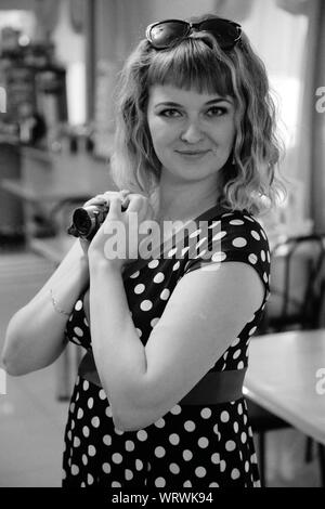 Portrait of Young Woman Wearing Polka Dot Dress Holding Home Video Camera Banque D'Images