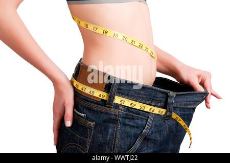 Femme vu la quantité de poids qu'elle a perdu. Contexte Isolé. Banque D'Images