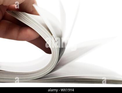Le tournant sur pages de magazine épais Banque D'Images