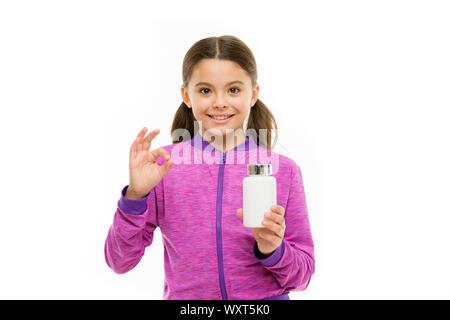 Enzymes pour une meilleure digestion. Pour une flore digestive. Complément alimentaire pour les enfants. Prendre des suppléments de vitamine. La vitamine et medicine concept. Fille enfant prendre des médicaments. Besoin de suppléments vitaminiques. Banque D'Images