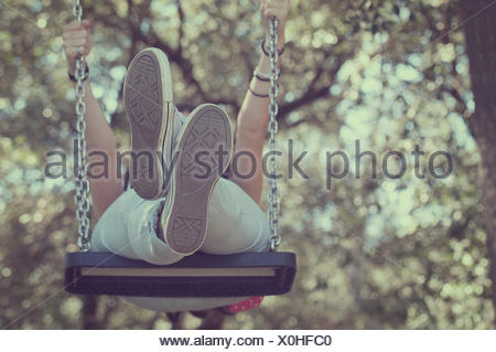 Low angle view of a young girl on a swing Banque D'Images