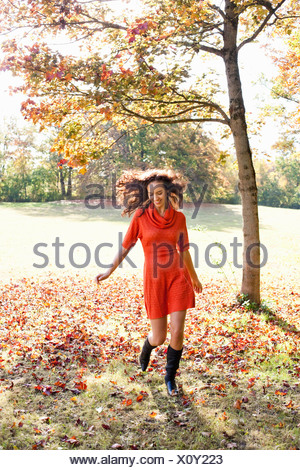 Young woman running in meadow