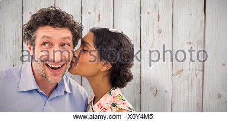 Image composite de Pretty woman kissing man on cheek Banque D'Images