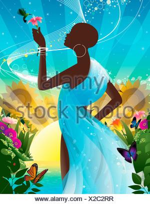 Silhouette of woman holding flower pour colibris (montage d'été colorés Banque D'Images