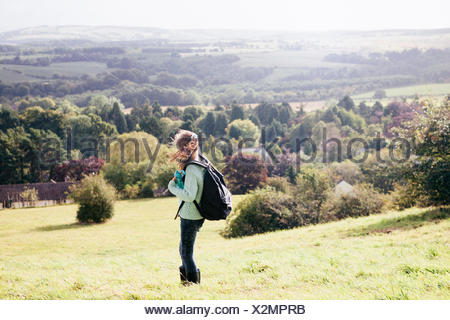Girl standing in field looking at view