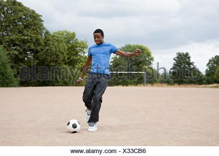 Teenage boy playing football