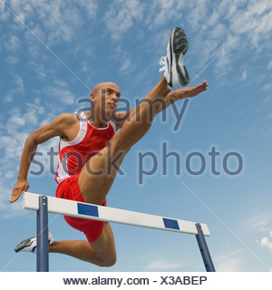 Runner sautant hurdle Banque D'Images