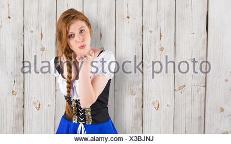 Image composite de l'Oktoberfest girl blowing a kiss Banque D'Images