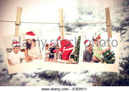 Image composite de cute little girl de décorer l'arbre de Noël avec son père Banque D'Images