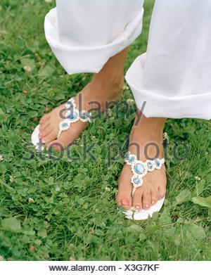 Pieds portaient des sandales Banque D'Images