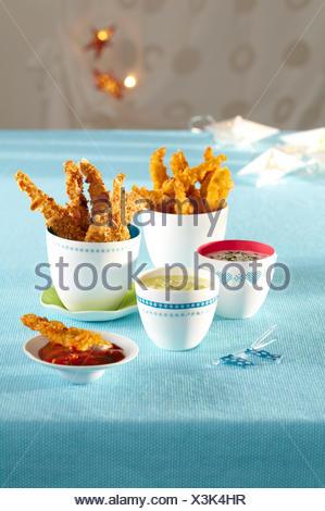 Nuggets de poulet avec dips Banque D'Images