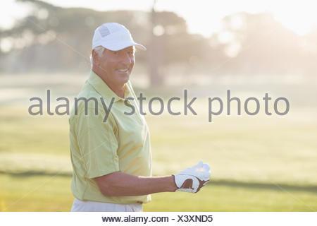 Portrait of smiling mature golfer