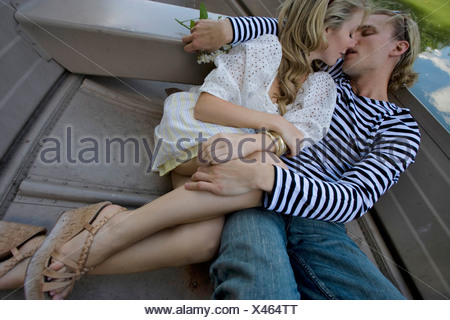 High angle view of a young couple relaxing in a boat Banque D'Images