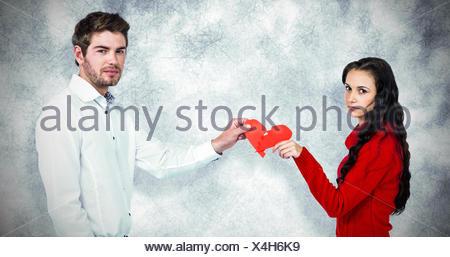 Image composite de portrait de couple holding red 12.2005 forme de coeur Banque D'Images