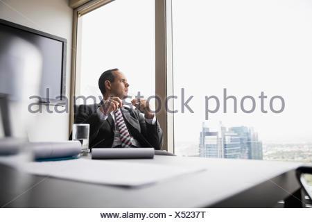 Pensive businessman Banque D'Images