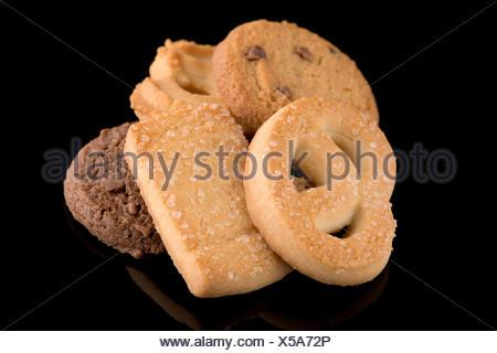 Cookies beurre sur noir Banque D'Images