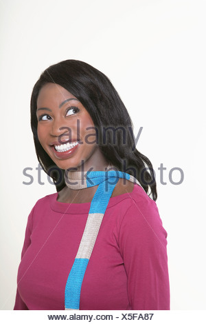 Les jeunes, smiling Woman wearing scarf, looking away Banque D'Images
