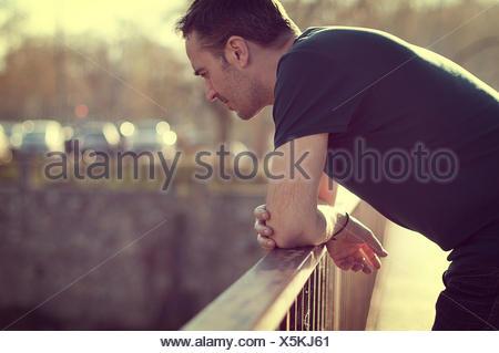 Man leaning on railing