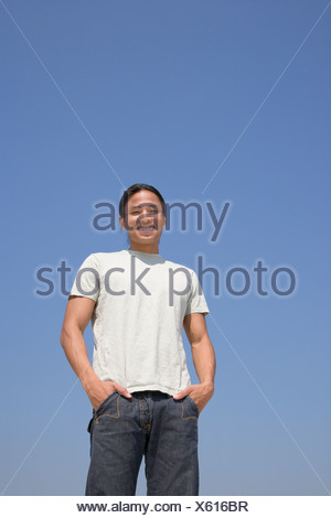 Asian man with hands in pockets Banque D'Images