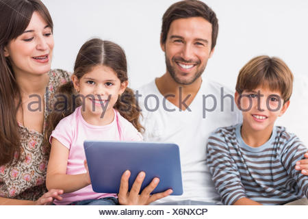 Happy family with tablet pc Banque D'Images