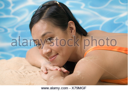 Woman reclining in swimsuit Banque D'Images