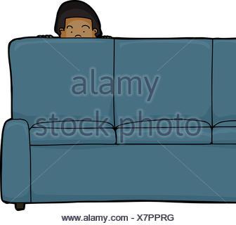 Un enfant d'Asie peeking de derrière un canapé Banque D'Images