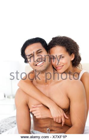 Portrait of a woman hugging her husband sitting together Banque D'Images