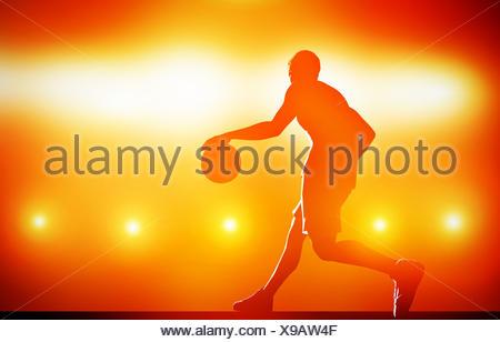 Basket-ball dribble silhouette avec balle sur fond rouge avec des feux d'action Banque D'Images