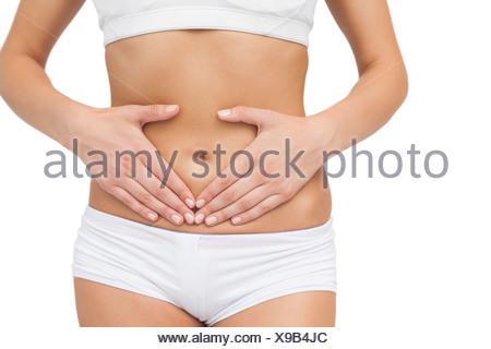 Mid section de slim woman avec ses mains Banque D'Images