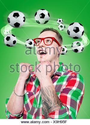 Jeune homme avec le vol de ballons autour de sa tête, Composite