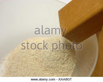 Moudre des grains moulin à maïs pain fabriqué à partir de grains entiers de céréales alimentaires repas macro aliment Banque D'Images