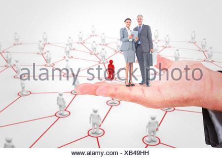 Image composite de business people using tablet computer Banque D'Images